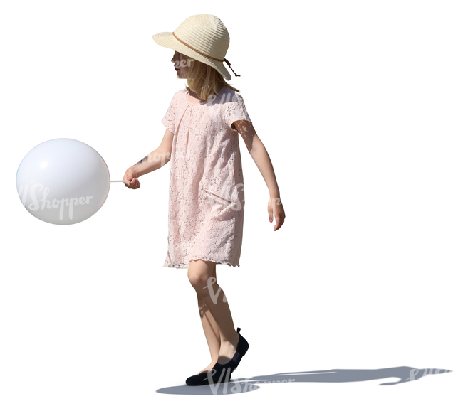 girl in a summer dress walking with a balloon in her hand