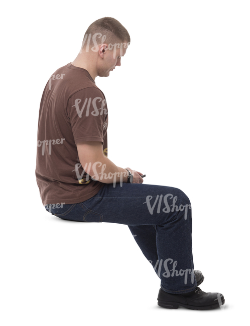 man sitting in a room and looking at his phone