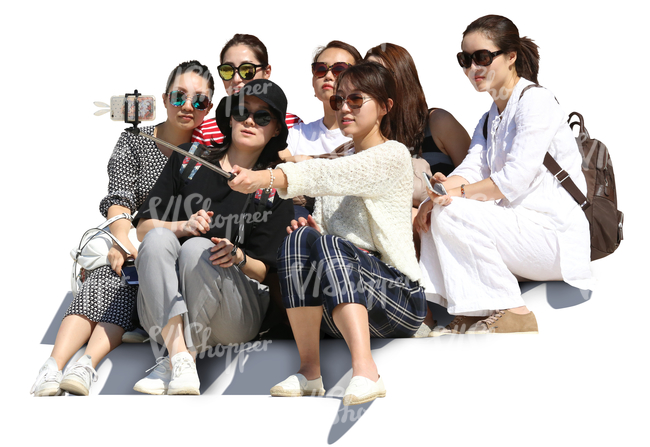 group of asian women sitting on the stairs and taking a selfie