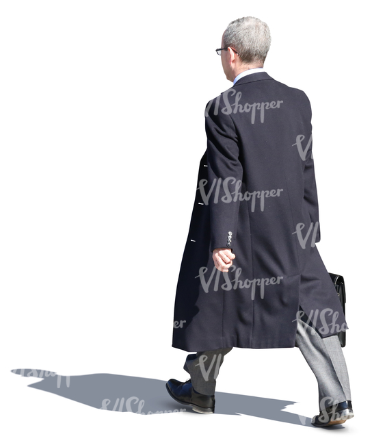 businessman in a black overcoat walking on the street