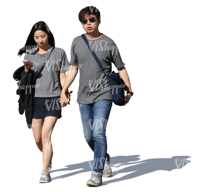 asian couple walking hand in hand