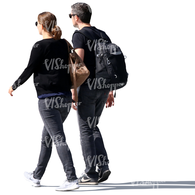 backlit man and woman walking side by side