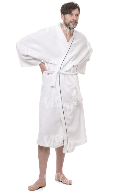 man in a white bathrobe standing in a spa