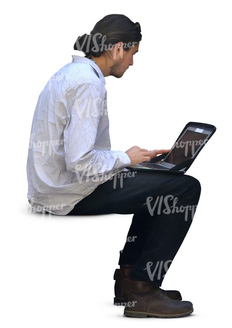 man sitting and working on his laptop