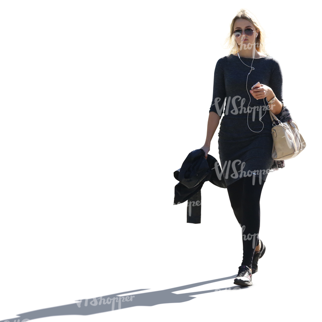 backlit blond woman in black clothes walking and listening to music