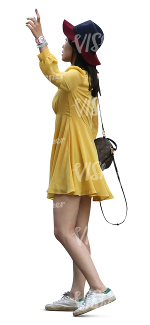 asian woman in a yellow summer dress standing