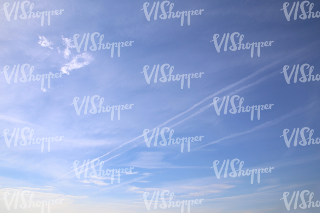 almost clear sky with contrails