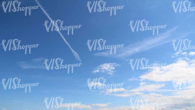 blue sky with clouds and contrails