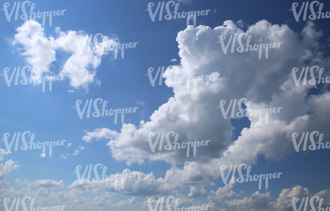 daytime sky with cumulus clouds